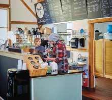 Two baristas stand behind the counter at Lake Elmo Coffee