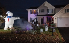 John Soma's Halloween yard display, featuring a graveyard, inflatable Stay Pufy Marshmallow Man and more.