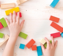 A child plays with blocks