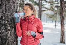 A woman drinks water to keep her hair, skin and body healthy during winter.