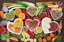 A spread of heart healthy foods, arranged in hearts.