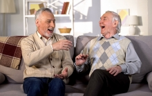 Older gentlemen laughing while having lively discussion