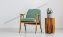 Two pieces of sustainable furniture - a chair and a side table - in a living room.