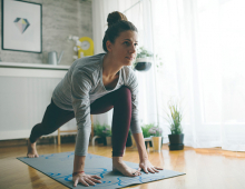 A woman does yoga as part of her fitness plan.