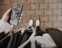 A woman browses some of the best podcast apps on her phone.