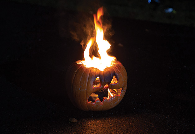 The flaming pumpkin, one of the signature pieces of John Soma's Halloween yard display in Woodbury.