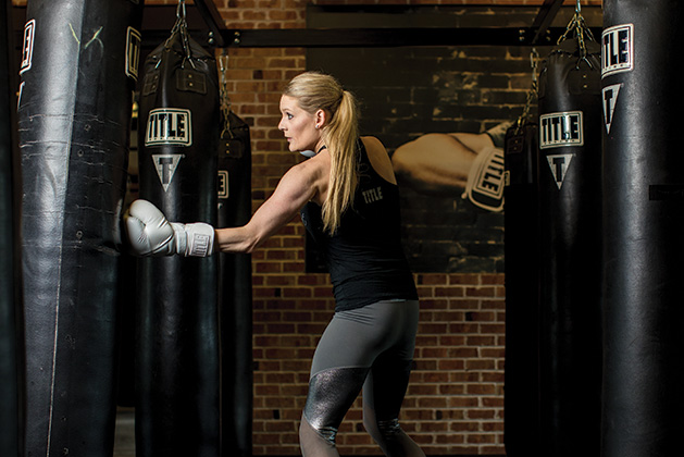 Sarah Krotz works a punching bag at TITLE Boxing Club Woodbury