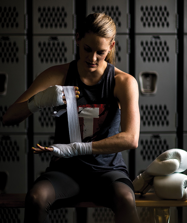 Sarah Krotz wraps her hands before kickboxing at TITLE Boxing Club Woodbury